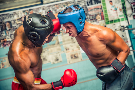Two boxer sparring on the ring - Athletes training in a boxe gym Stock Photo