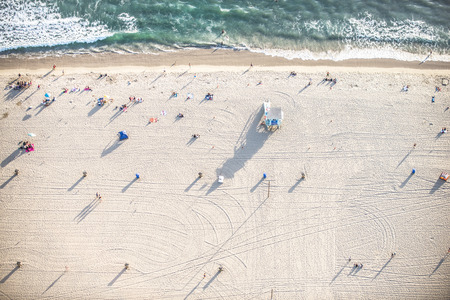beach view: Santa Monica beach, drone view - People sunbathing on the beach and swimming in the ocean