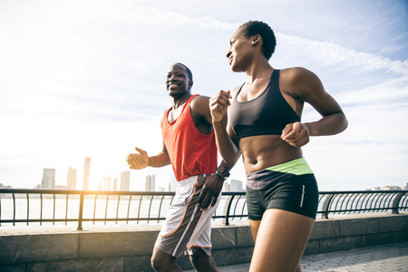 Couple running in New York - Sportive man and woman training outdoors Stock Photo