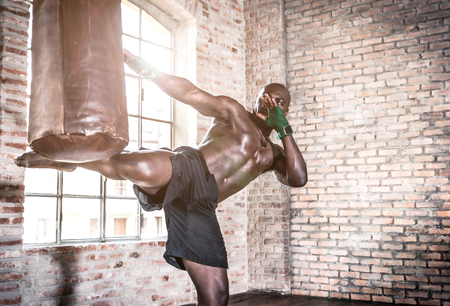 Black fighter training hard in his gym Stock Photo