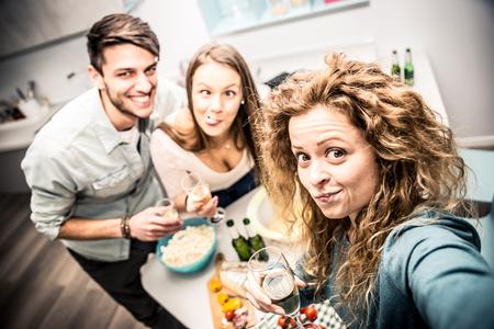 degustating: Group of friends having dinner home Stock Photo