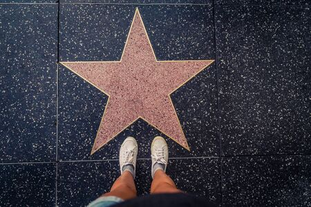 walk of fame: Tourist photographing her with an empty star on the Walk of Fame in Hollywood Editorial