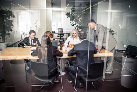 working in office: Office people working and talking about business plans Stock Photo