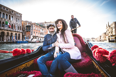 venice: Couple of lovers on vacation in Venice, Italy - Tourists having a trip on a venetian gondola