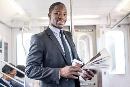 pendular: Businessman in full suit in New York subway metro