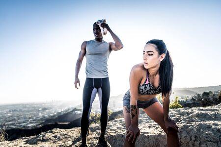 Couple training outdoors Stock Photo