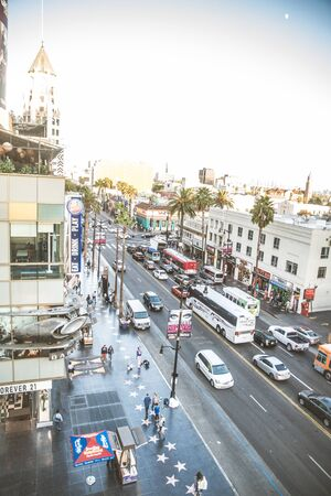 walk of fame: HOLLYWOOD, CA - OCTOBER 12, 2016: People visit Walk of Fame in Hollywood. Hollywood Walk of Fame features more than 2,500 stars with inscribed celebrity names.