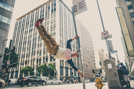 trickster: Parkour man doing tricks on the street - Free runner training his acrbatic port outdoors