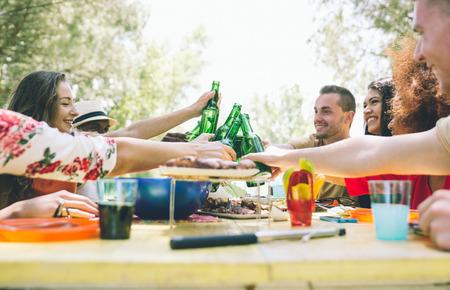 Friends eating at picnic photo