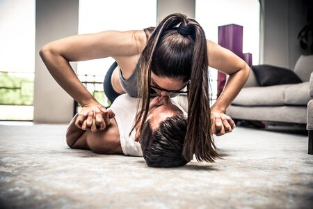 ankles sexy: Couple making tag fitness in the living room at home