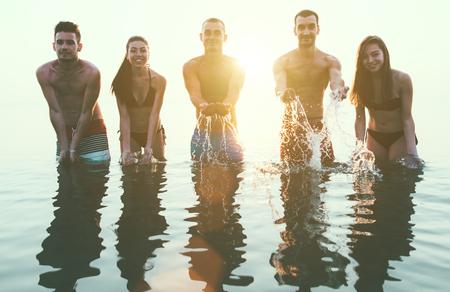 Friends splashing water photo