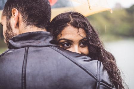 Happy couple under the rain photo