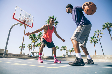 afroamerican: Friends playing basketball - Afro-american players having a friendly match outdoors