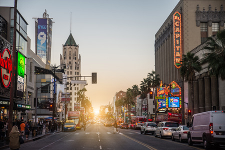 walk of fame: HOLLYWOOD, CA - OCTOBER 12, 2016: View of Hollywood Boulevard at sunset. In 1958, the Hollywood Walk of Fame was created on this street as a tribute to artists working in the entertainment industry.
