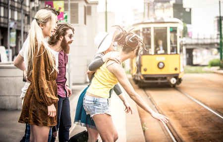 18 to 30s: Group of teens waiting the tram