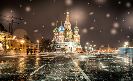 moscow: Saint basil cathedral in Moscow. Night time with snow flakes Stock Photo