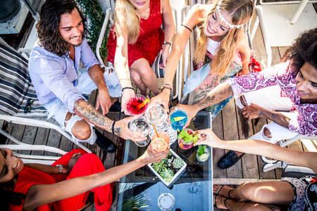 Friends making party in a lounge bar Foto de archivo