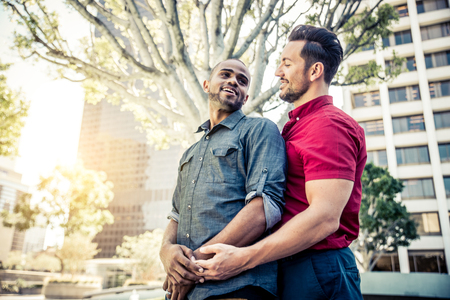 Homosexual couple at a romantic date outdoors - Gay couple in love flirting and having fun Stock Photo