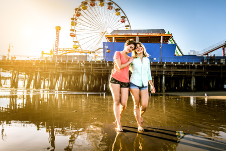 couple dating: Lesbian couple playing and dating on the beach Stock Photo