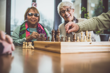 ホスピス内活動を行う高齢者のグループ 写真素材