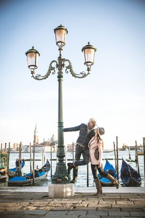kisses: Beautiful couple in Venice, Italy - Lovers on a romantic date and kissing in Saint Mark Square, Venice