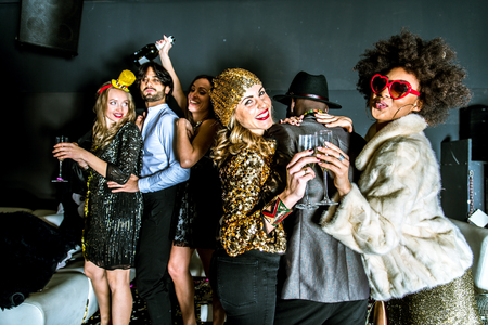 Multi-ethnic group of friends celebrating in a nightclub - Clubbers having party Standard-Bild