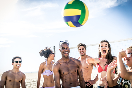 santa monica: Group of friends playing beach volley on the beach and having fun Stock Photo