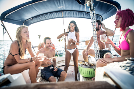 aperitif: Friends making fish barbecue on the yacht