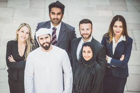 Arabic and western business people portrait. Motivational concept Standard-Bild