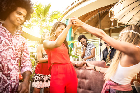 rapping: Friends dancing in a lounge bar, with dj set Stock Photo