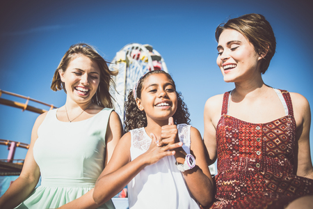 daughter in law: happy gay couple spending time together with their adopted daughter