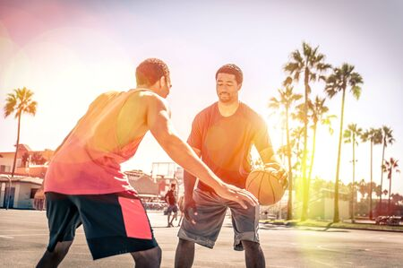 Two basketball players playing outdoor in LA photo