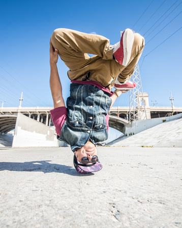 Two bbys ding some stunts - Street artist breakdancing outdrs photo