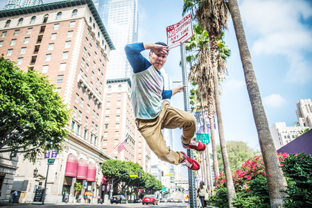 Parkour man doing tricks on the street - Free runner training his acrbatic port outdoors photo