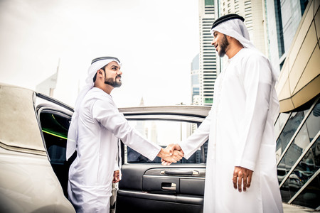 Arabic businessmen in Dubai Фото со стока