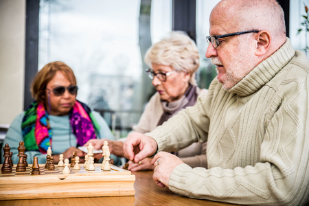 almshouse: Senior adults in a nursing home for the elderly doing leisure activities