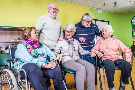 elderly adults: Senior adults in a nursing home for the elderly Stock Photo
