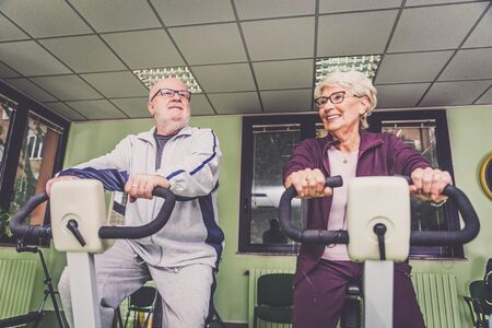 almshouse: Senior adults in a nursing home for the elderly doing sport activities