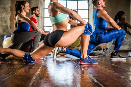 Multi-ethnic group of people training in a gym - Personal  trainer and sportive persons  in a fitness class Reklamní fotografie - 75180997