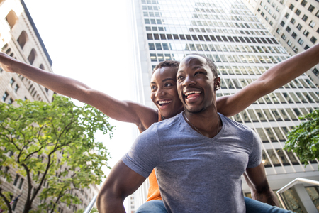 Smiling couple of lovers having fun in New York streets