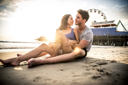 young couple kiss: Happy couple spending time in Santa monica Stock Photo