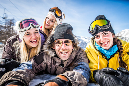 Group of friends with ski on winter holidays - Skiers having fun on the snow Stok Fotoğraf