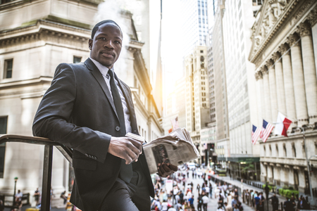 Businessman in full suit walking in Wall Street, New York Stock Photo - 76038810
