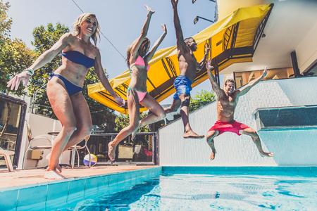 Multi-racial group of friends having fun in a swimming pool