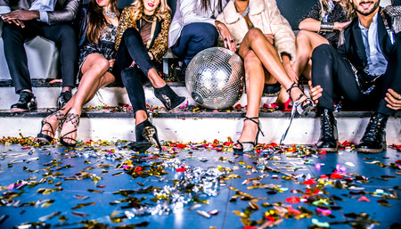 Multi-ethnic group of friends celebrating in a nightclub - Clubbers having party Banco de Imagens
