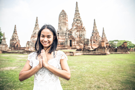 Young woman praying at Ayutthaya Historical Park Stock Photo