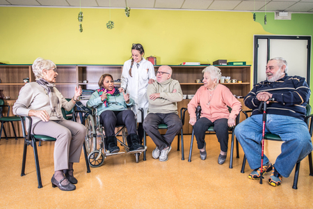 almshouse: Senior adults in a nursing home for the elderly Stock Photo