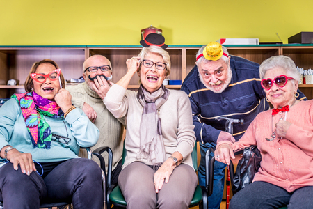elderly adults: Senior adults in a nursing home for the elderly having fun Stock Photo
