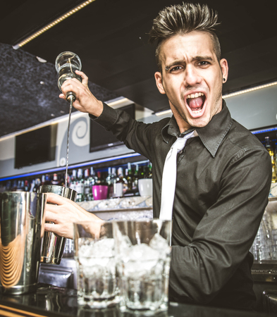 Flair bartender in action behind the club bar Stockfoto