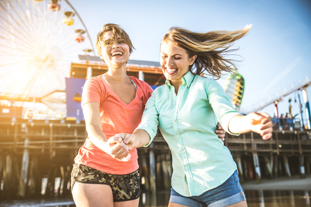 Lesbian couple playing and dating on the beach Stock Photo
